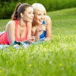 Two smiling fitness girls outdoor — Stock Photo