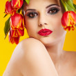 Beauty woman portrait with wreath from flowers on head — Stock Photo #26862141