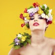 Summer young woman with colorful flowers in hair. — Stock Photo #26862151