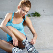 Beautiful young woman rink on roller-skate — Stock Photo