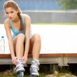 Beautiful young woman rink on roller-skate in green park — Stock Photo