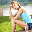 Young beautiful woman drinking water after fitness exercise — Stock Photo