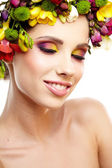 Beautiful young woman with flower — Stock Photo