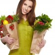 Stock Photo: Girl holding a bag of food