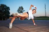 A young sport girl dancing modern dances — Stock Photo