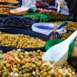 Olive display on market stall — Stock Photo #27812853