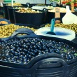 Olive display on market stall — Stock Photo #27816301