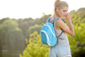 Young blond woman hiking with scenery in thegreen landscape back — Stock Photo