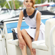 Sexy fashionable woman standing in a port fashion style, yachts  — Stock Photo