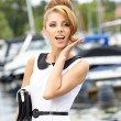 Attractive fashion girl on the dock with boat — Stock Photo #28198885