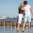Couple walking on beach together — Stock Photo