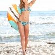 Beautiful sexy young woman surfer girl in bikini with surfboard — Stock Photo