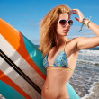 Stock Photo: Surfer girl on the beach