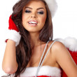 Beautiful sexy girl wearing santa claus clothes — Stockfoto