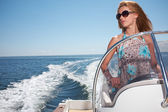 Woman in Dress Driving A Speedboat Fast At Sea — Stock Photo