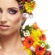 Young woman and flowers in her hair — Stock Photo