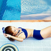 Beautiful young woman at a pool — Stock Photo