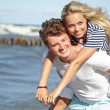 Stock Photo: Young happy couple having fun on the beach.