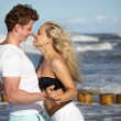 Young happy couple having fun on the beach. — Stock Photo