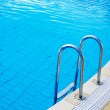 Part of swimming pool with blue water — Stock Photo #29771095