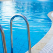 Part of swimming pool with blue water — Stock Photo #29771099