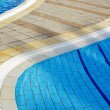 Stock Photo: Part of swimming pool with blue water