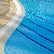 Part of swimming pool with blue water — Stock Photo