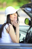 Portrait of beautiful summer woman in the car — Stock Photo