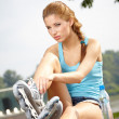Young woman rink on roller-skate — Stock Photo