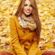 Woman with autumn leaves — Stok fotoğraf