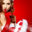 Portrait of beautiful sexy girl wearing santa claus clothes — Stock Photo #31127617