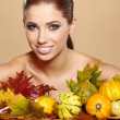 Woman with autumn pumpkin and leaves. — Stock Photo #31437889