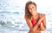 Young beautiful happy smiling cheerful tanned woman — Stock Photo