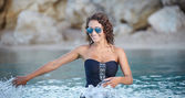 Beautiful sexy woman in bikini posing in water — Stock Photo