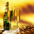 Glass of champagne against golden background — Stock Photo #31917435