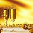 Glass of champagne against golden background  — Stock Photo