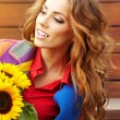 Fashion woman with sunflower at outdoor. — Stock Photo