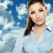 Portrait of smiling business woman, isolated on sky background  — Stock Photo