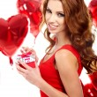 Happy young woman holding gift — Stock Photo #31919489