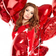 Beautiful girl with red balloons hearts — Stock Photo #31919507