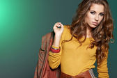 Beautiful high fashion model in autumn clothes posing — Stock Photo