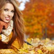 Autumn woman on leafs — Stock Photo #31985589