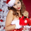 Beautiful sexy girl wearing santa claus clothes with christmas — Stock Photo
