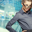 Portrait of happy smiling business woman  over office  backgroun — Stock Photo