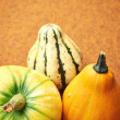 Decorative pumpkin isolated on brown background. Halloween and h — Stock Photo