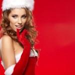 Beautiful sexy girl wearing santa claus clothes — Stock Photo #32376735