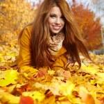 Autumn woman on leafs — Stock Photo #32376785