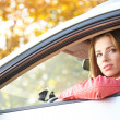 Beautiful young sexy woman in car looking from window on autumn — Stock Photo #32782021