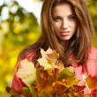 Stock Photo: Beautiful autumn womin golden park