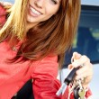Car driver woman smiling showing new car keys and car. — Stock Photo #32939159